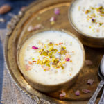Sabudana Kheer in two bowls garnished with nuts and rose petals