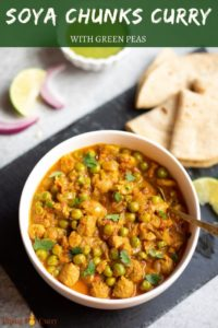 Soya nuggets and green peas curry in a white bowl with rotis in the side