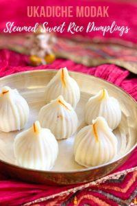 Ukadiche Modak (sweet rice dumplings) in a plate and lord Ganesha idol in the back