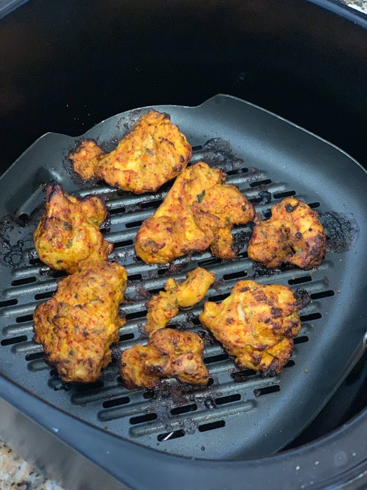 cooked chicken tikka bites in an air fryer