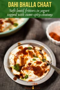 Dahi Bhalla Chaat - Lentil fritters in a bowl topped with yogurt and chutneys