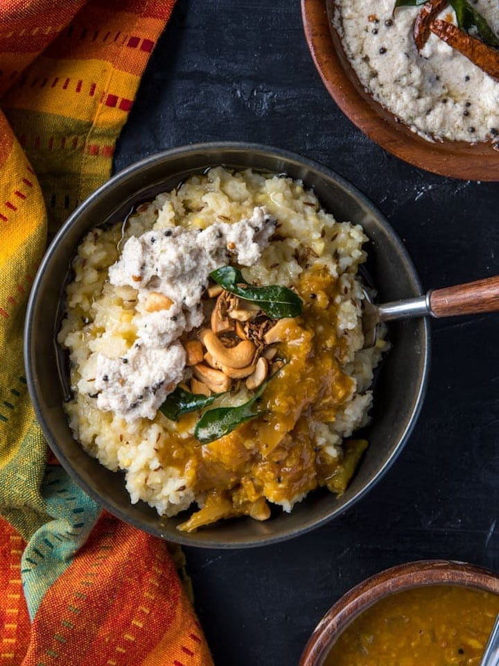 Pongal rice topped with chutney and sambar