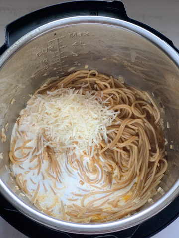 Shredded Cheese and cream on spaghetti in the instant pot