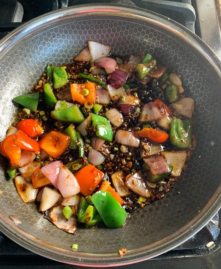 Chinese sauté with sauce, onions and colorful bell peppers