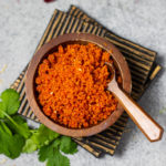 Dry red chutney powder in a small wooden bowl
