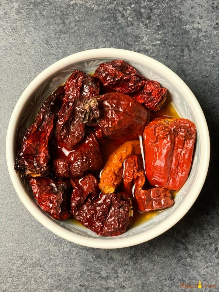 Soaked Kashmiri red chilli in a white bowl