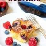 Air Fryer Berry Bread pudding served in a white plate with fresh berries on the side