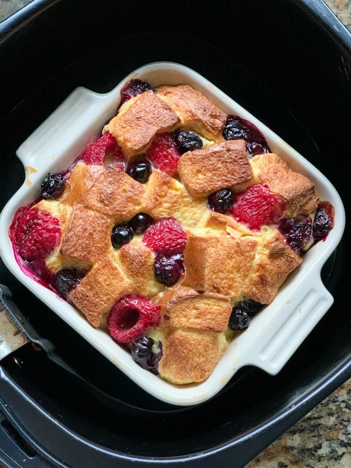 Bread pudding with berries in an air fryer basket