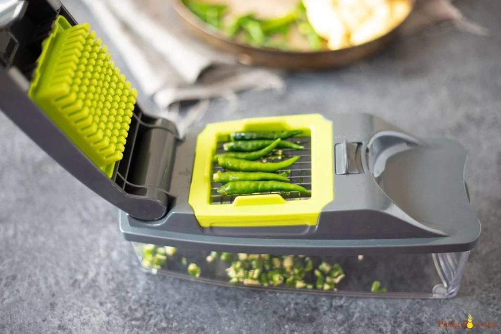 chopping fresh green chilis using a chopper