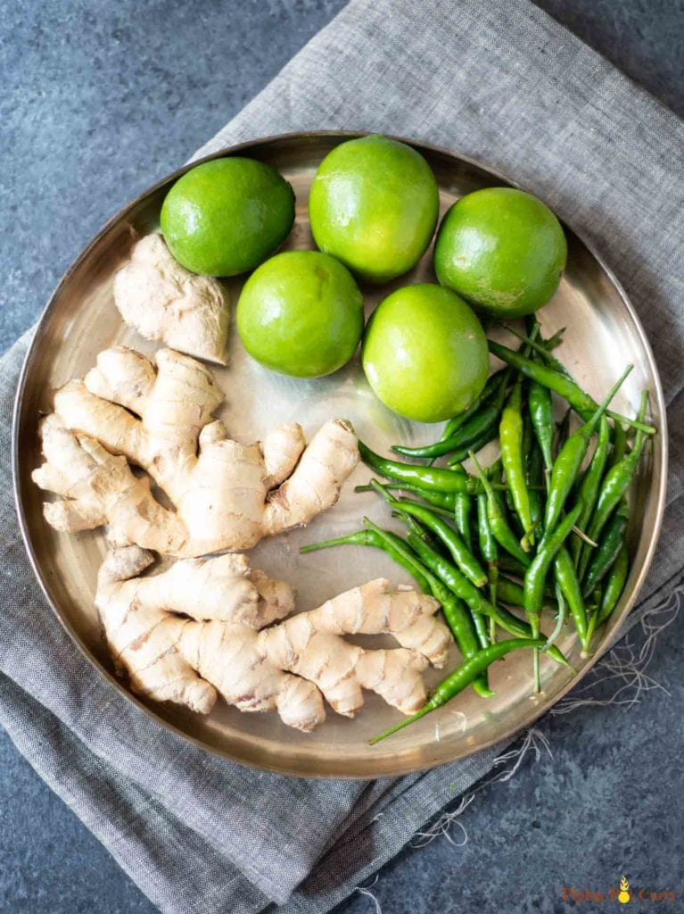 Ginger, green chili and lime in a large plate