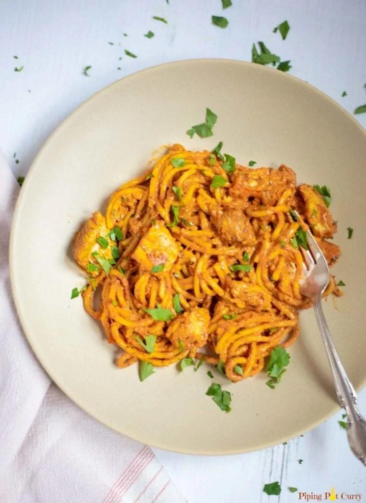 Chicken Spaghetti pasta in a plate garnished with cilantro