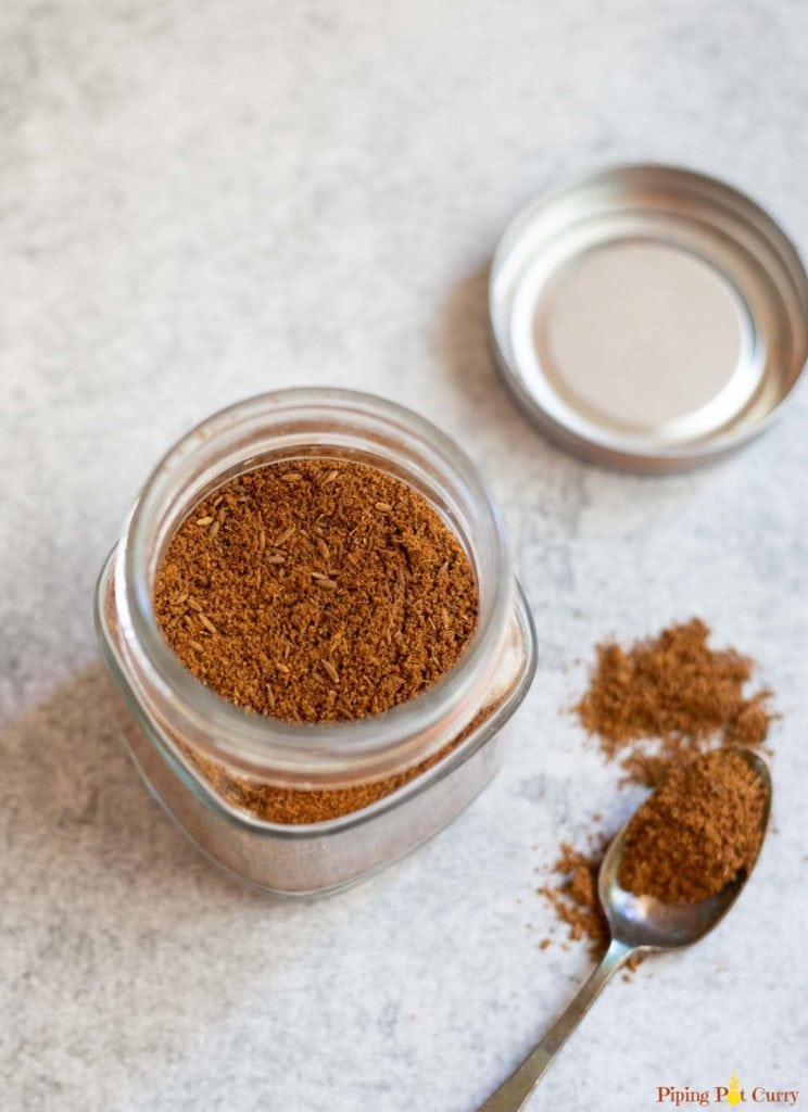 Ground cumin in an air tight glass container.