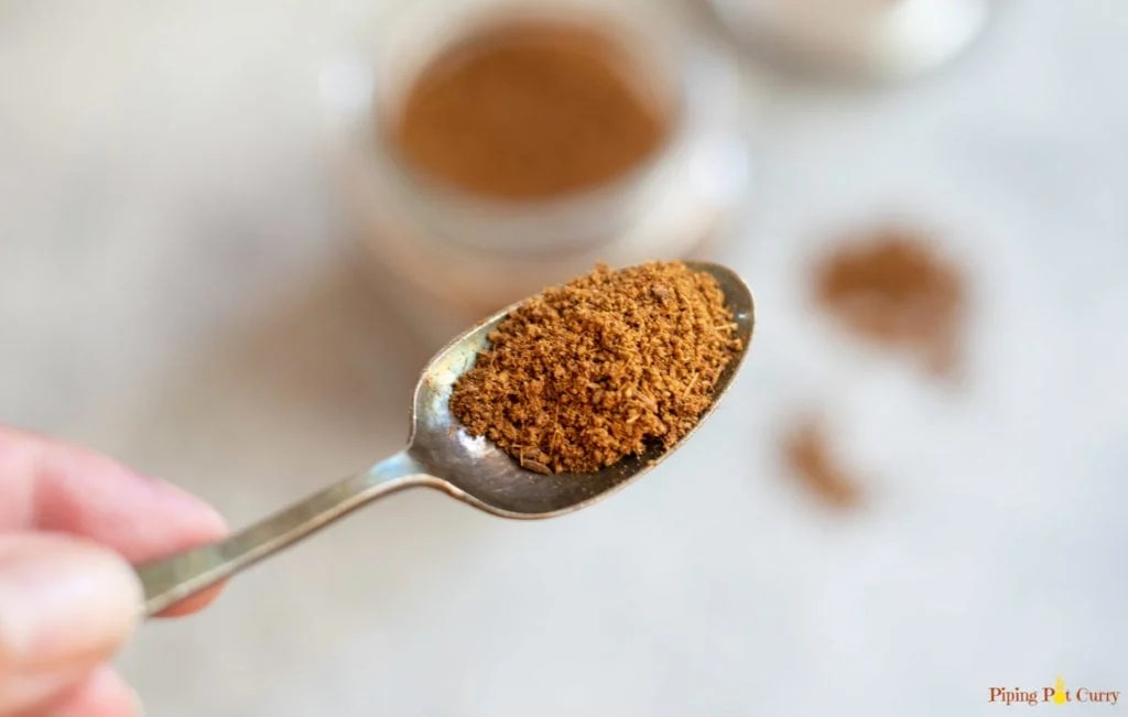 Ground Cumin in a spoon