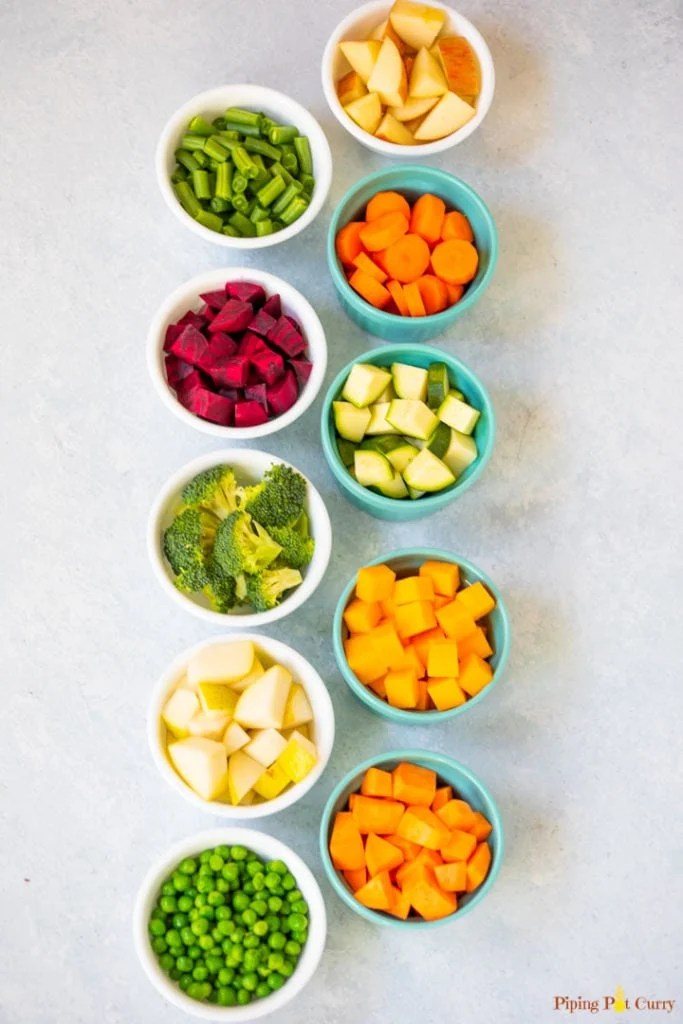 small bowls of cubed fruits and veggies