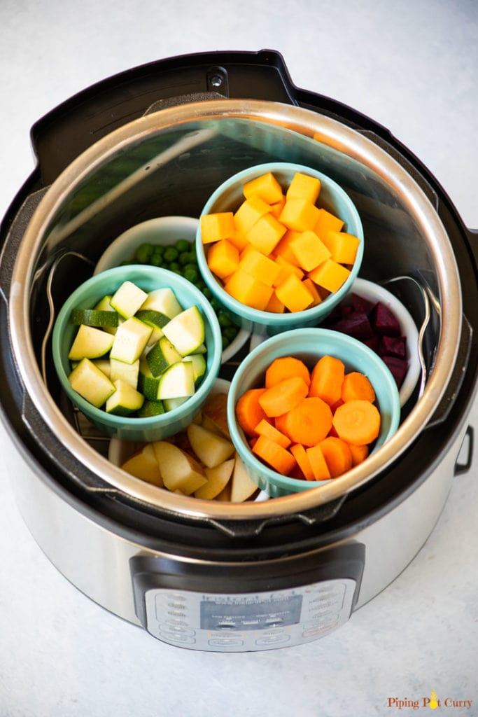 2 layers of ramekins with diced veggies to make instant pot baby food