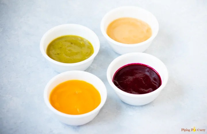 4 bowls of baby food purees