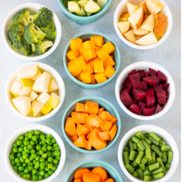 Ramekins with a variety of diced veggies to make pureed baby food