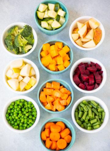 Ramekins with a variety of diced veggies to make pureed baby food