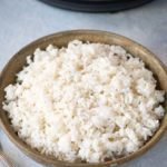 White Rice in a bowl in front of an instant pot