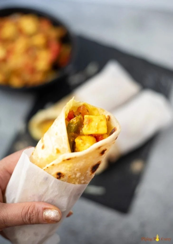 Paneer Frankie Roll in hand with some more Kathi Rolls in the back