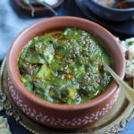 Saag Aloo (Spinach curry with potatoes) in a clay pot