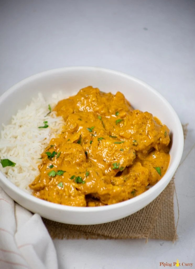 Coconut Chicken Curry served over rice in a white bowl
