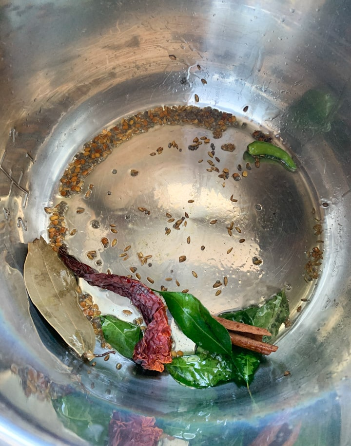 Red chili, mustard seeds and curry leaves tempering in the instant pot