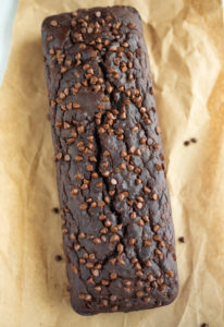 double chocolate banana bread with chocolate chips on a parchment paper