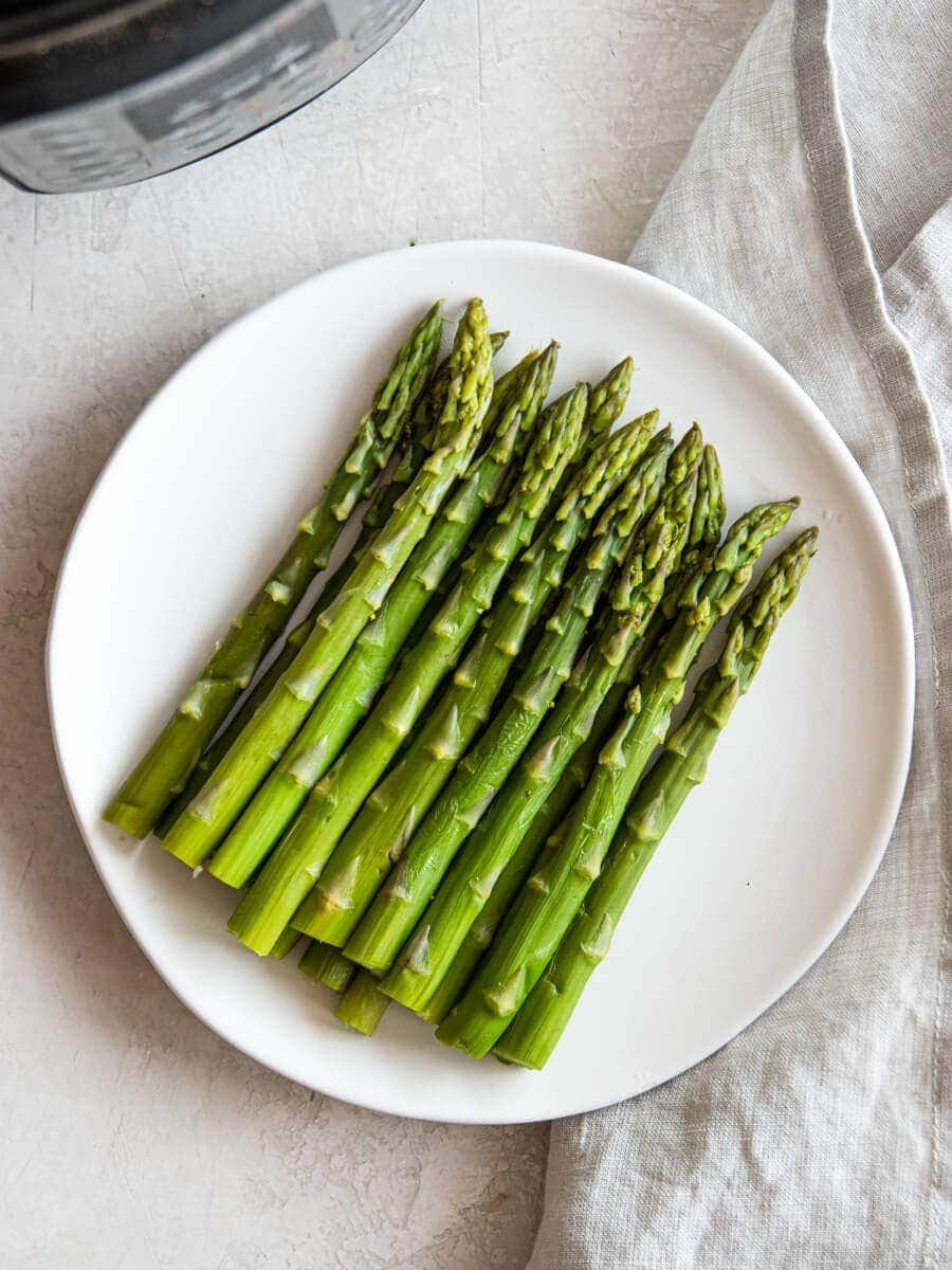 Cooked Asparagus on a white plate