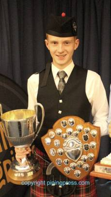 Champion Piper Donald Stewart with his trophies