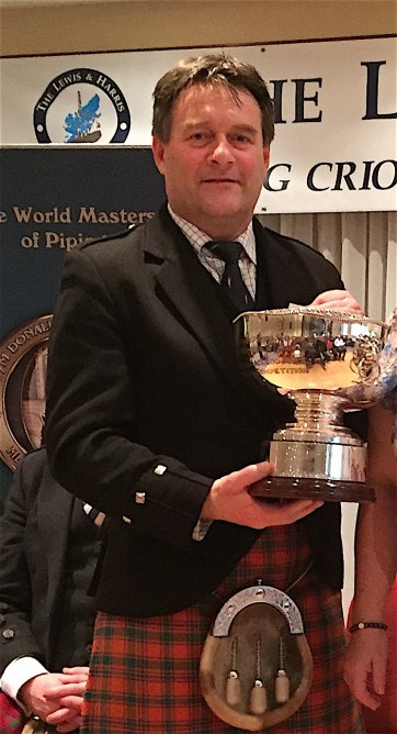 Angus MacColl with the H&J trophy