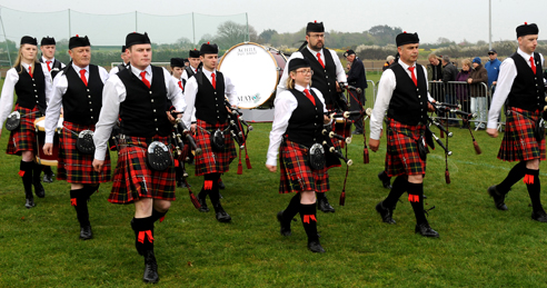 Pipe Major Conor Molloy (left) and champions Achill Pipe Band, Co Mayo