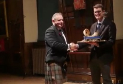 Rodedrick MacLeod winner of the 2016 Glenfiddich Championship receives his trophy from Mr Addington