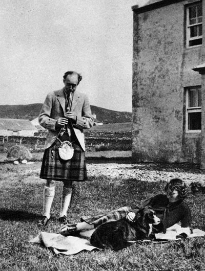 Seton Gordon doing dome practice at his home at Duntuilm on Skye. Also in the picture are his dog Dileas and his wife