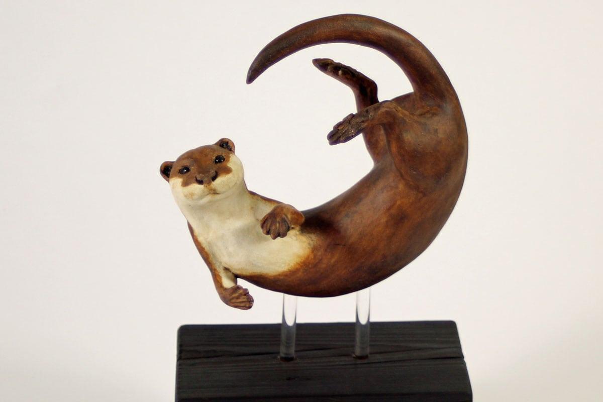 Otter, In a Spin, medium - ceramic clay sculpture
