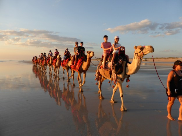 Riding camels on Cable Beach