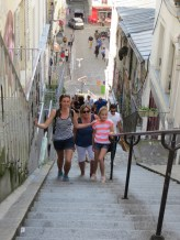 Climbing the steps to Sacre Couer