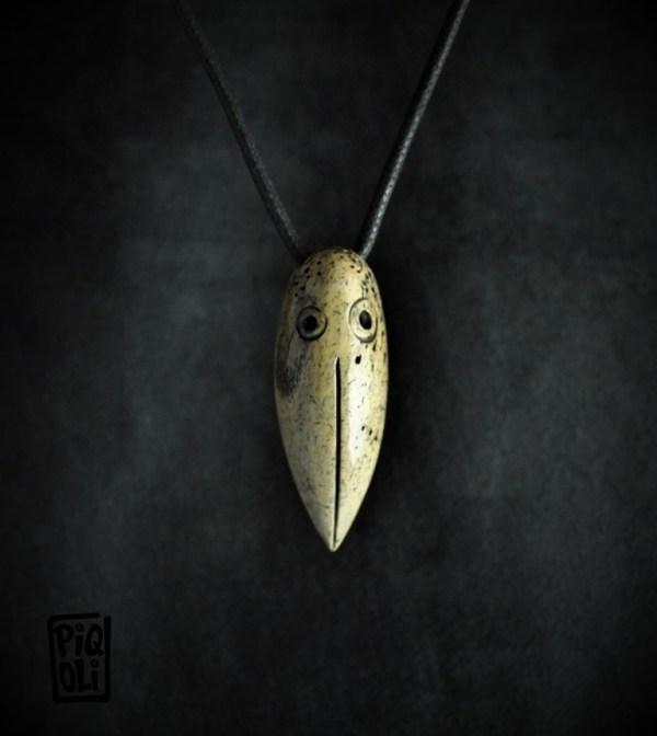 cap d' oiseau inuit en os de morse fossile