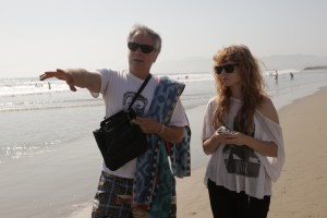 "Mark Pirro pointing ahead and directing actress Stef Dawson on Venice Beach for ""Rage of Innocence."""