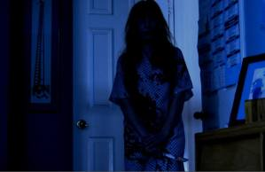 "Raven Sutton looking sinister as she approaches her enemy in a dark room in ""Rage of Innocence."""