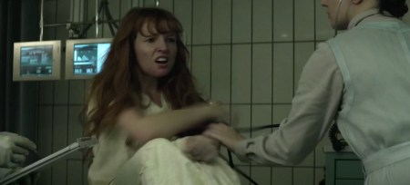 Rage of Innocence star Stef Dawson in hospital scene in Mockingjay.