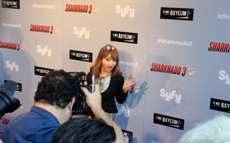 Judy Tenuta on red carpet being photographed at Sharknado 3 premiere