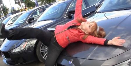 "Comic Judy Tenuta test driving a Maserati for a segment of ""The World Accordion to Judy."""
