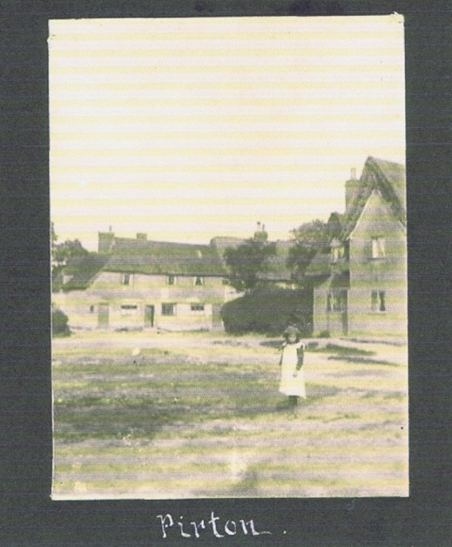 The house faced onto Chipping Green[ Market Green], the girl is standing at the edge of the pond which was used by the blacksmith next to the Cat and Fiddle.