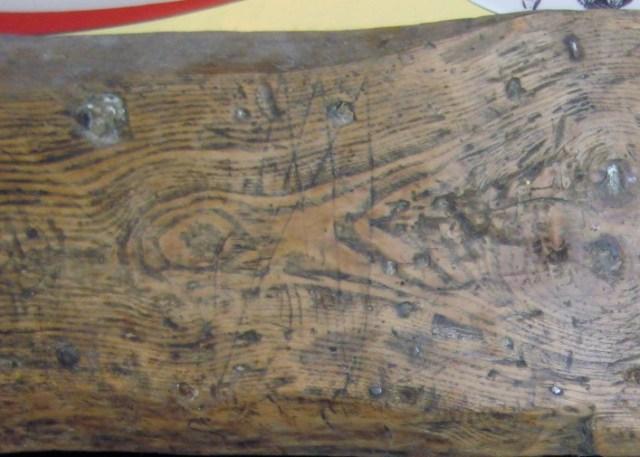 Apotropaic mark on the fireplace beam.