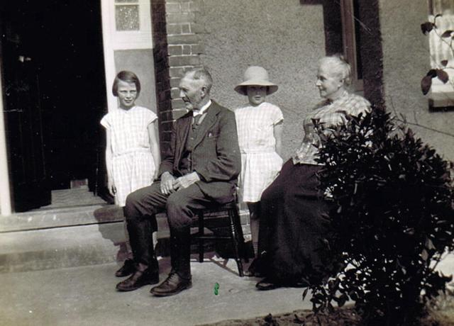 The  twins with Grandpa and Grandma Sheppard outside the bungalow in Walnut Tree Rd