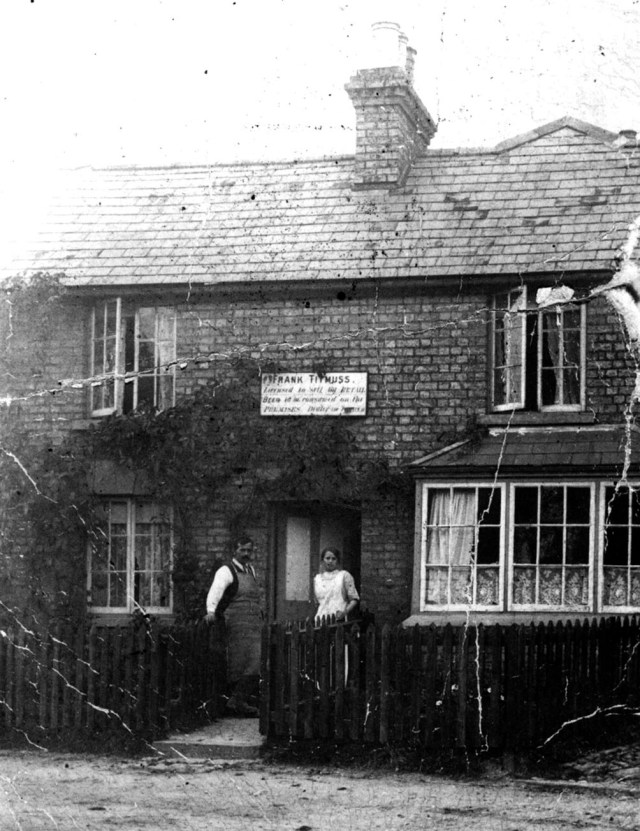 Fred and Ruth Titmuss outside the Blacksmiths Arms opposite the pond