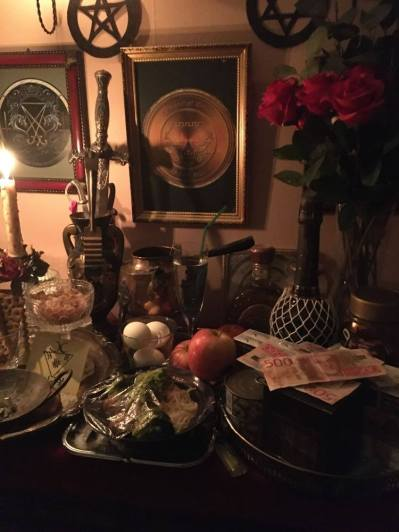 This is my altar. I made offerings on the behalf of the client when I was doing a petition spell for him. The demons involved were Lucifer and Belial.