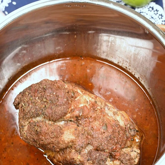Cooked pork roast in a pressure cooker.