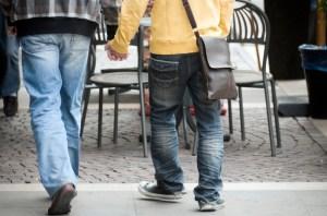 city boys holding hands